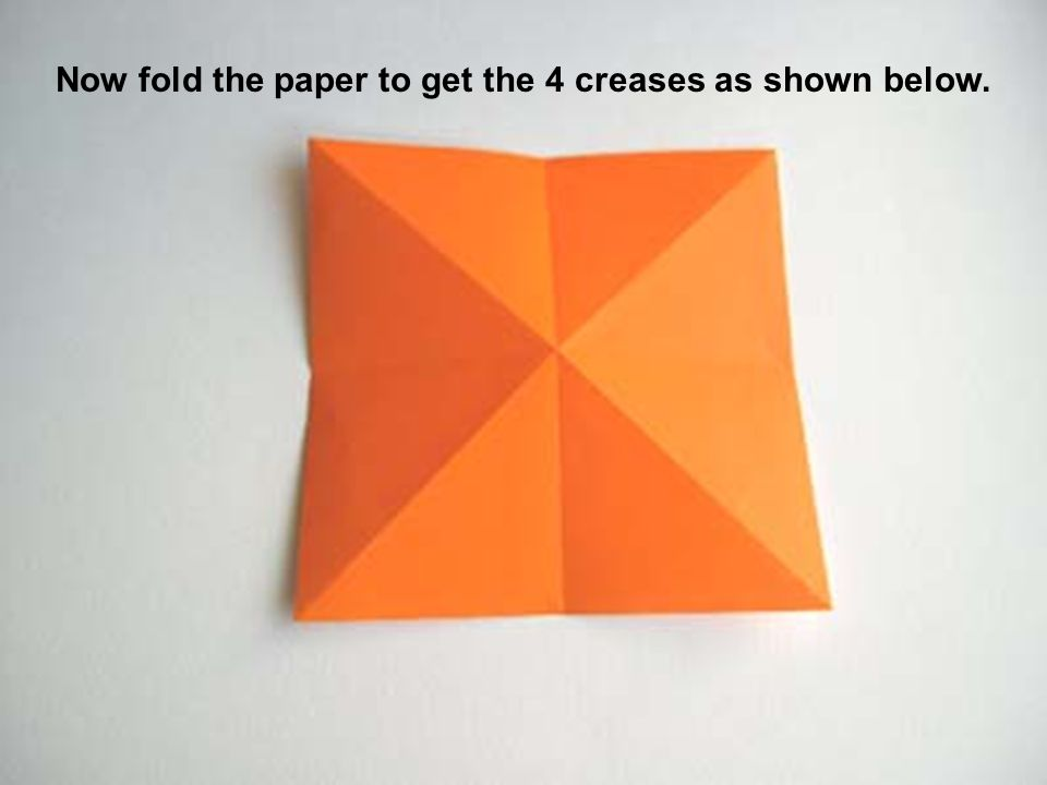 Now fold the paper to get the 4 creases as shown below.