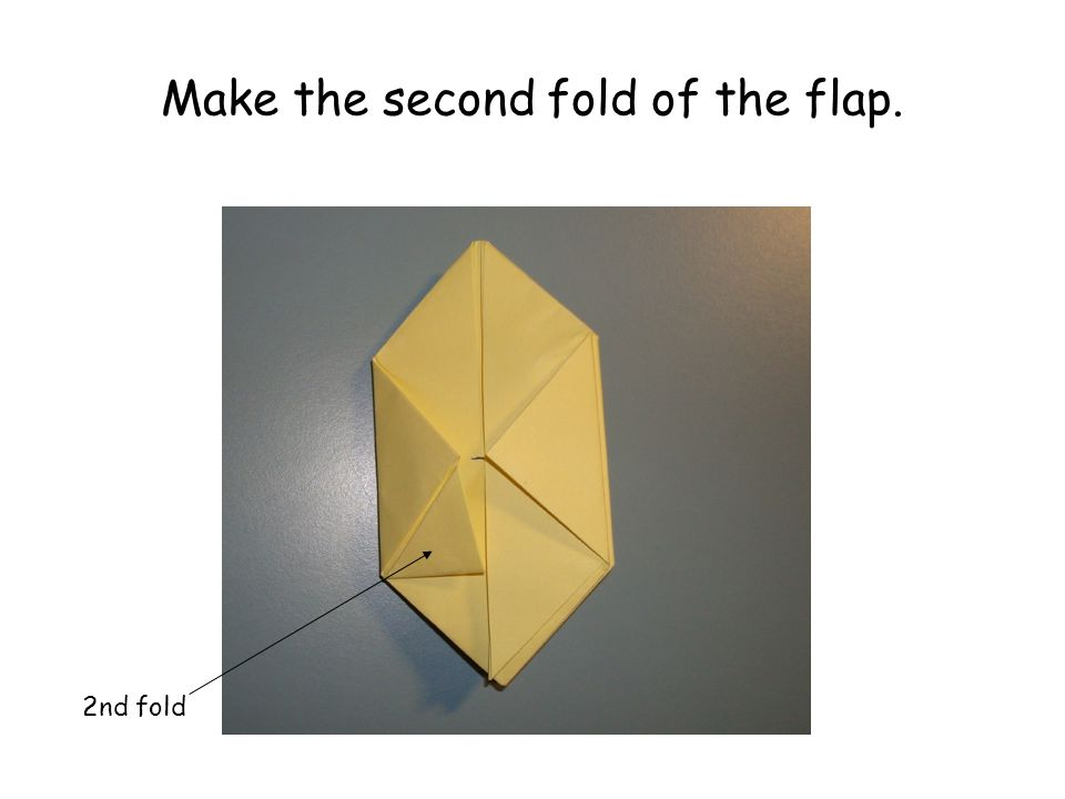 Make the second fold of the flap. 2nd fold