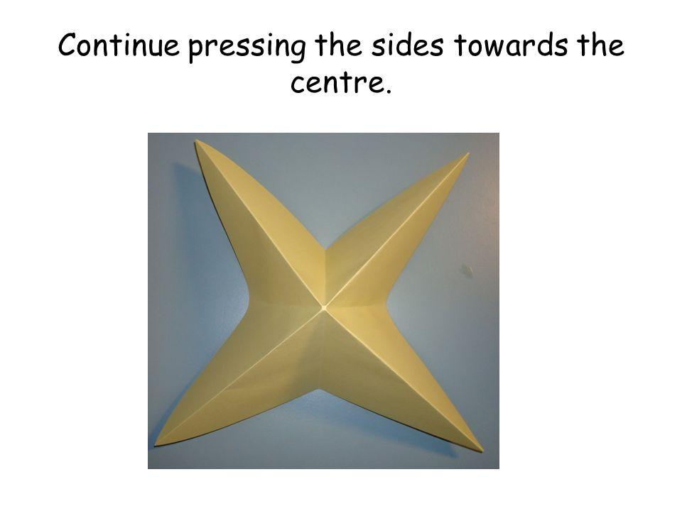 Continue pressing the sides towards the centre.