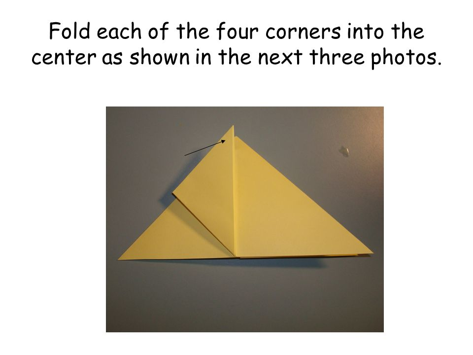 Fold each of the four corners into the center as shown in the next three photos.