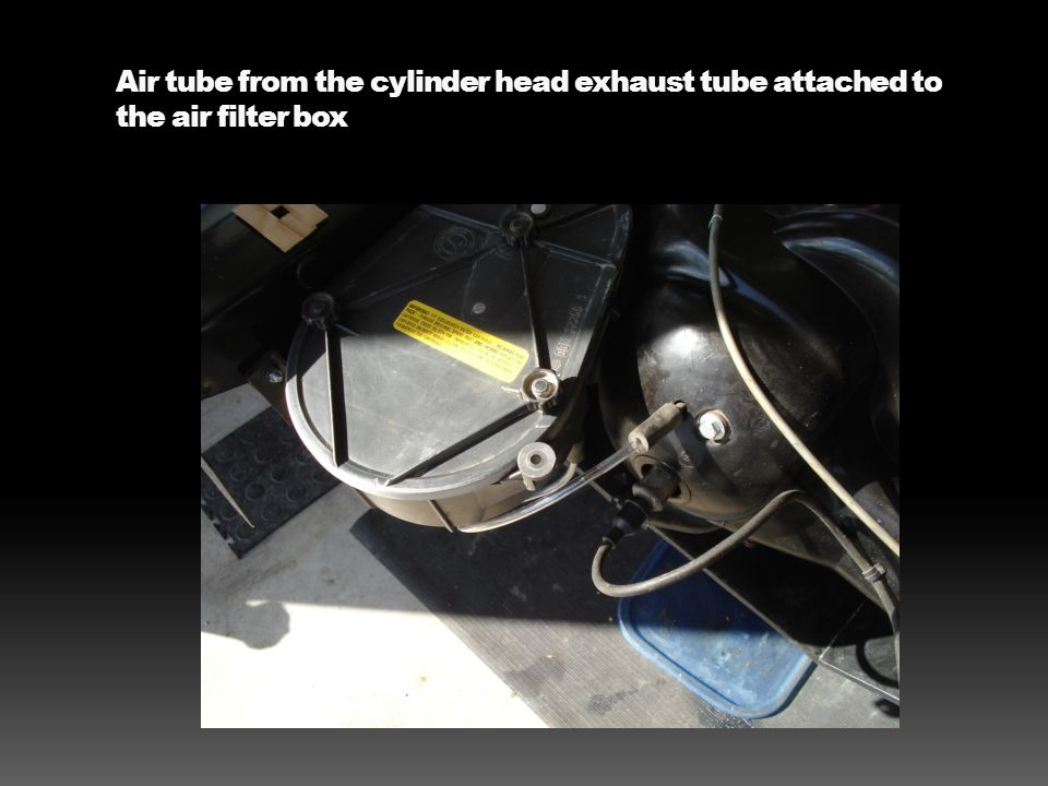 Air tube from the cylinder head exhaust tube attached to the air filter box