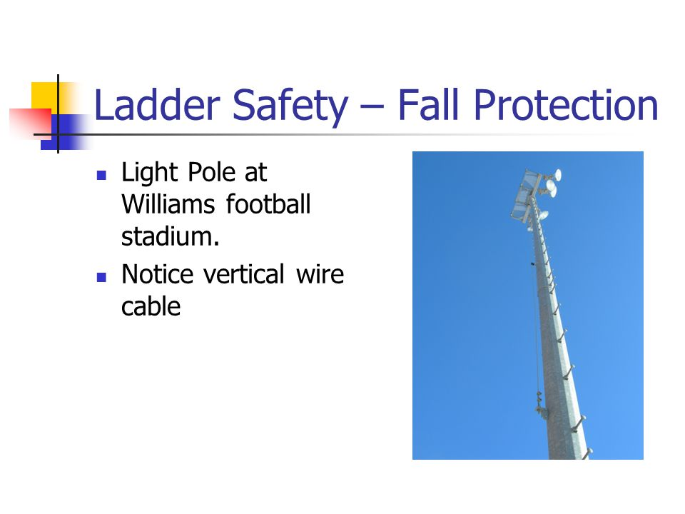 Ladder Safety – Fall Protection Light Pole at Williams football stadium. Notice vertical wire cable