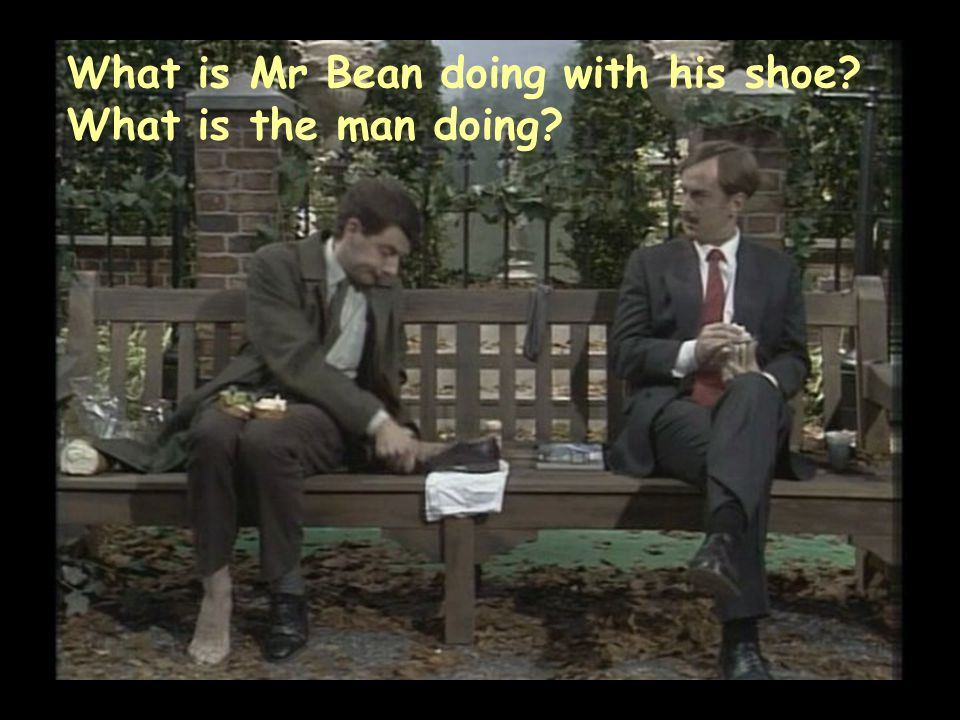 What is Mr Bean doing with his shoe? What is the man doing?