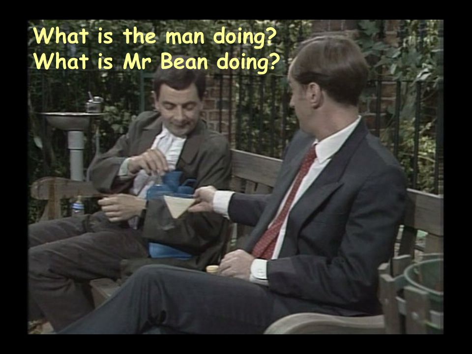 What is the man doing? What is Mr Bean doing?