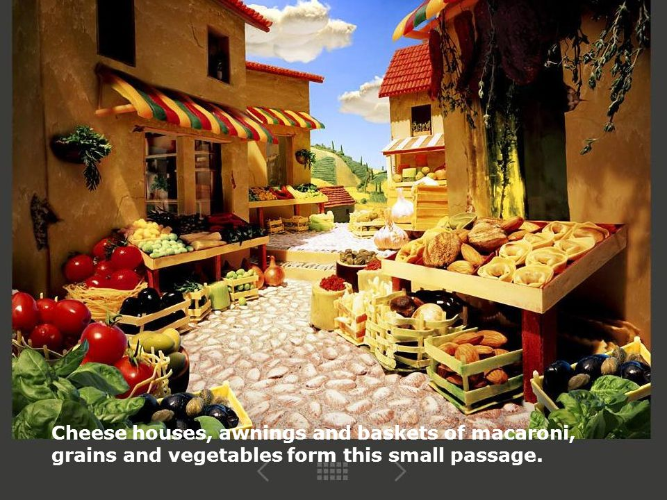 Cheese houses, awnings and baskets of macaroni, grains and vegetables form this small passage.
