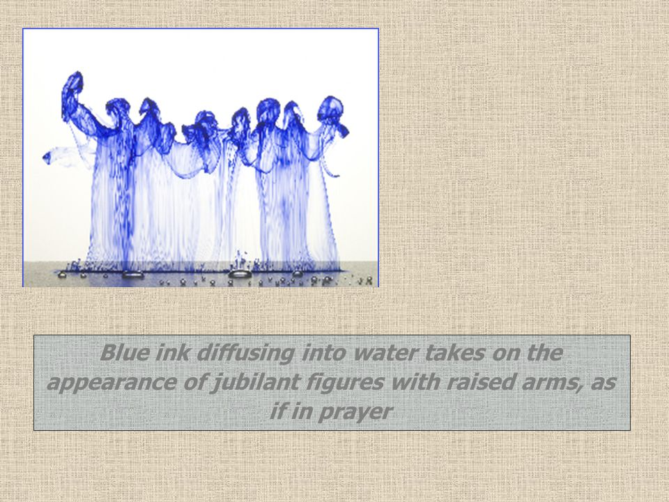 Blue ink diffusing into water takes on the appearance of jubilant figures with raised arms, as if in prayer