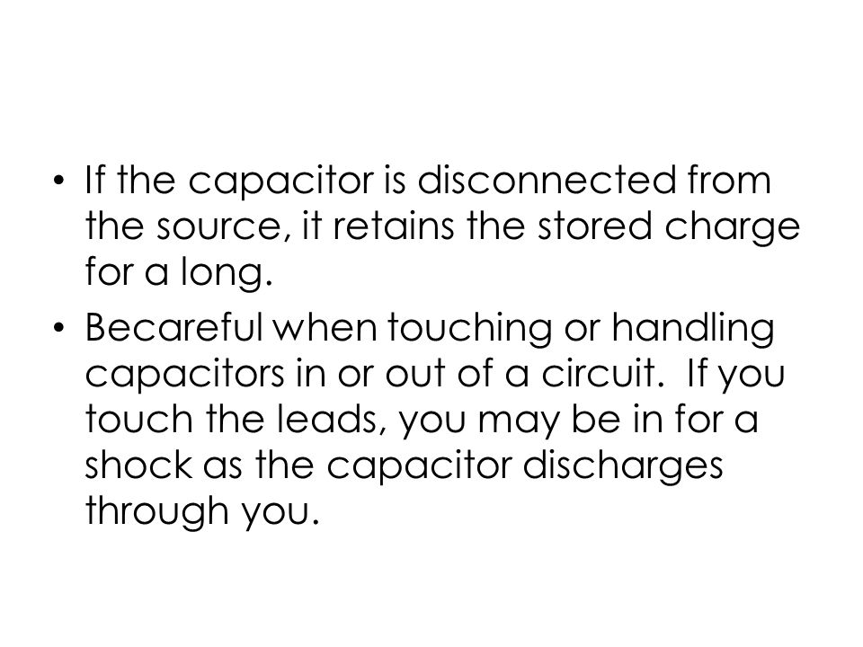 If the capacitor is disconnected from the source, it retains the stored charge for a long.