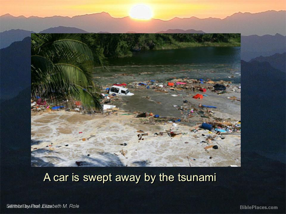 A car is swept away by the tsunami