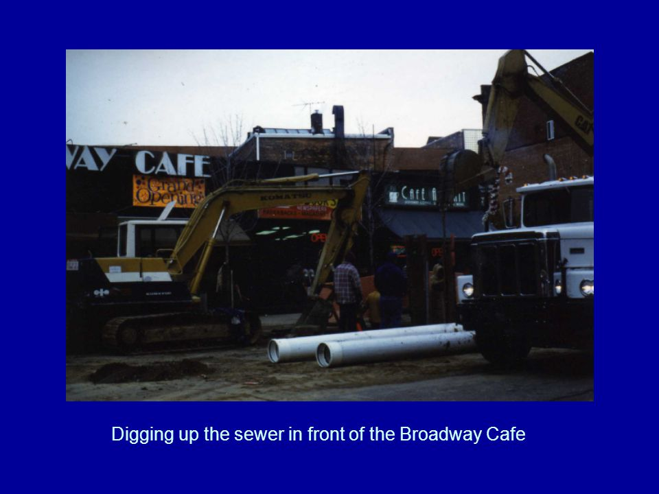 Digging up the sewer in front of the Broadway Cafe