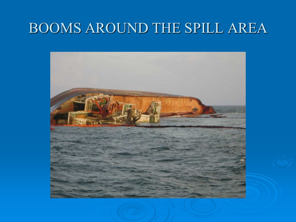 BOOMS AROUND THE SPILL AREA