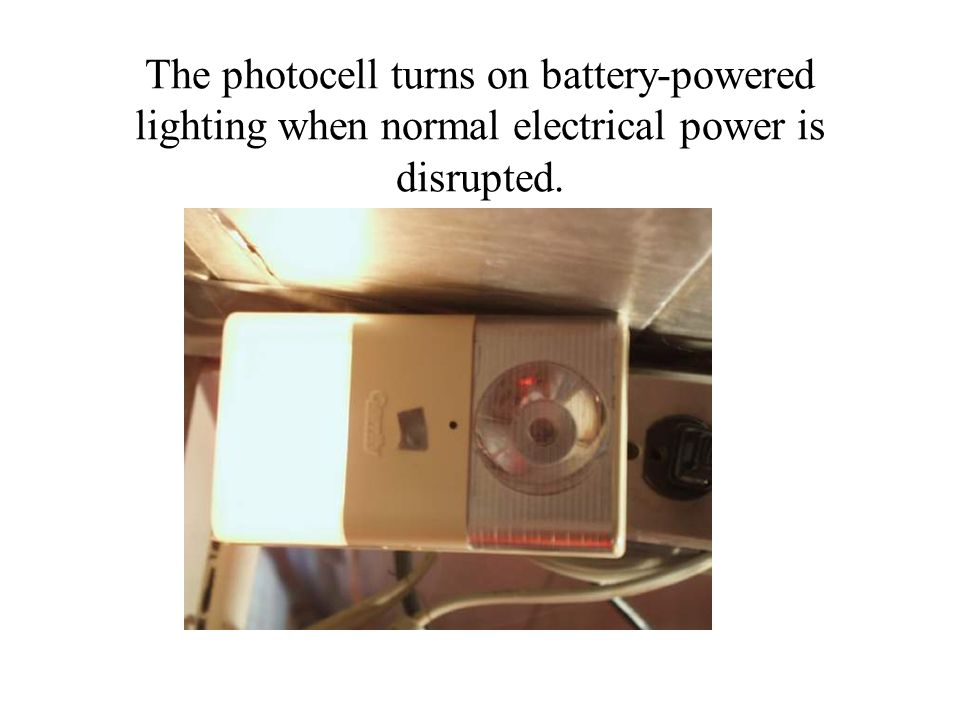 The photocell turns on battery-powered lighting when normal electrical power is disrupted.