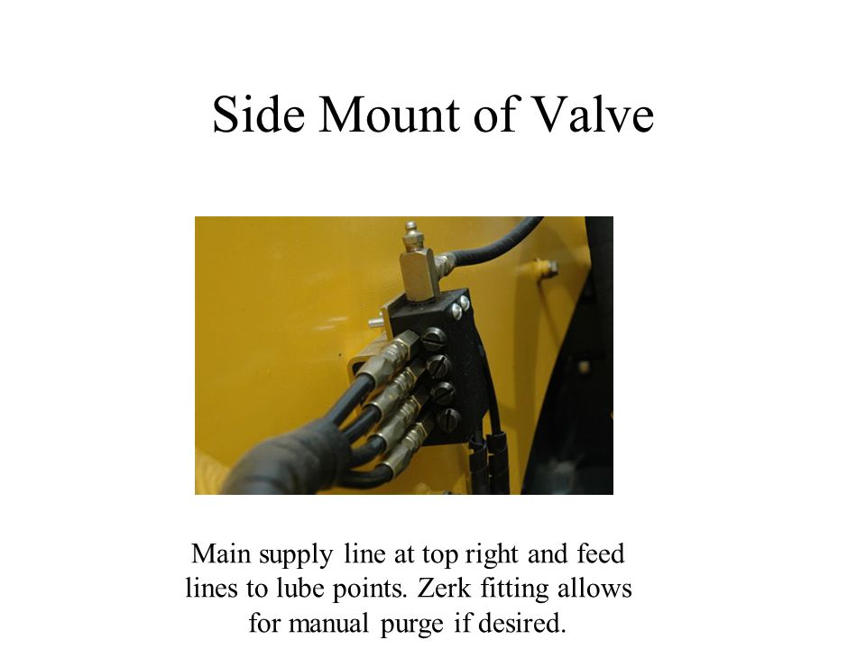 Side Mount of Valve Main supply line at top right and feed lines to lube points.