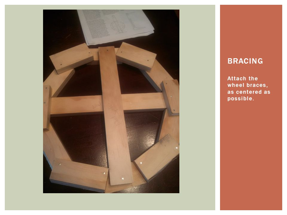Attach the wheel braces, as centered as possible. BRACING