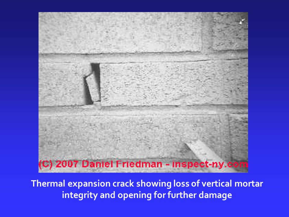 Thermal expansion crack showing loss of vertical mortar integrity and opening for further damage