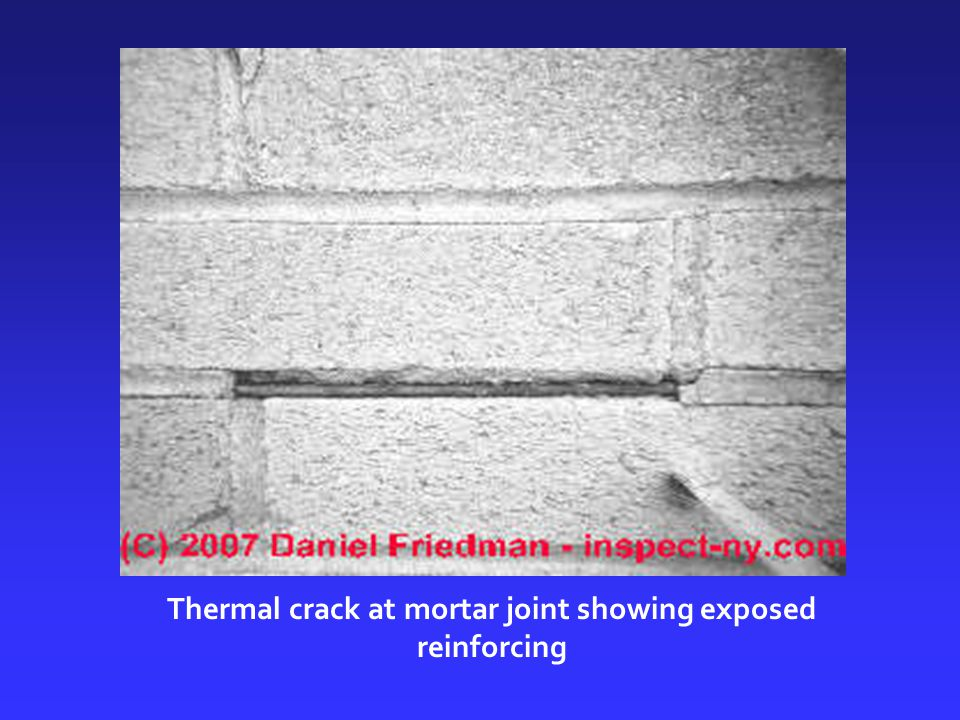 Thermal crack at mortar joint showing exposed reinforcing