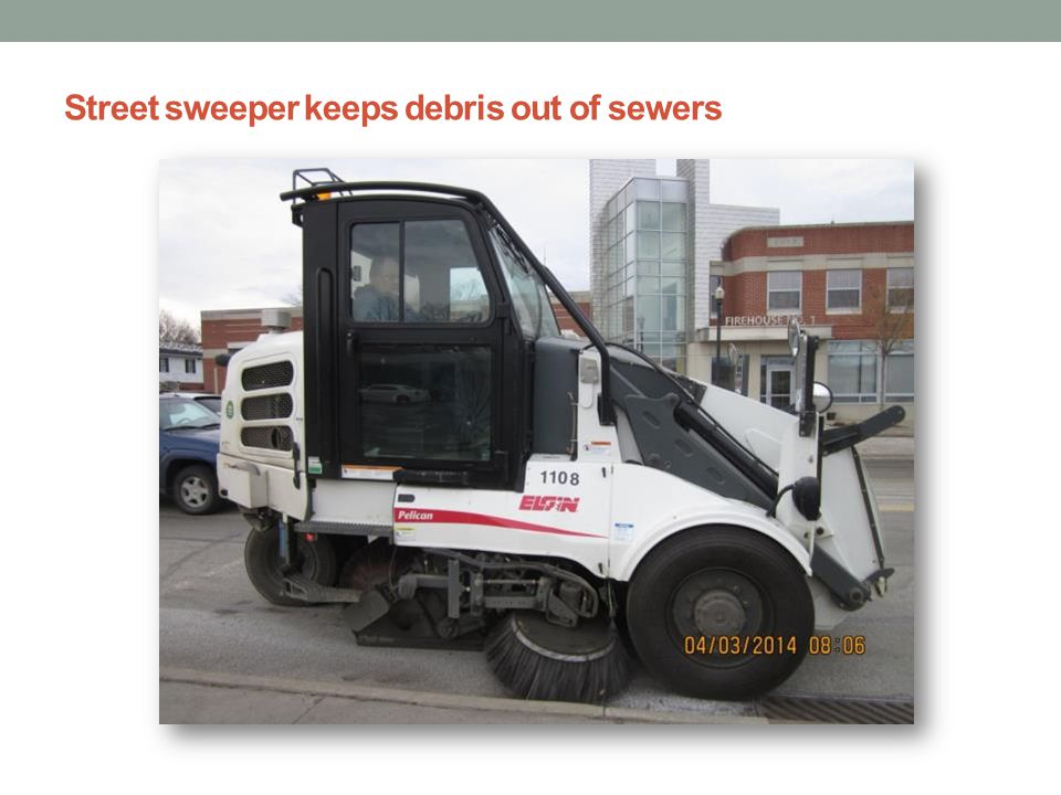 Street sweeper keeps debris out of sewers