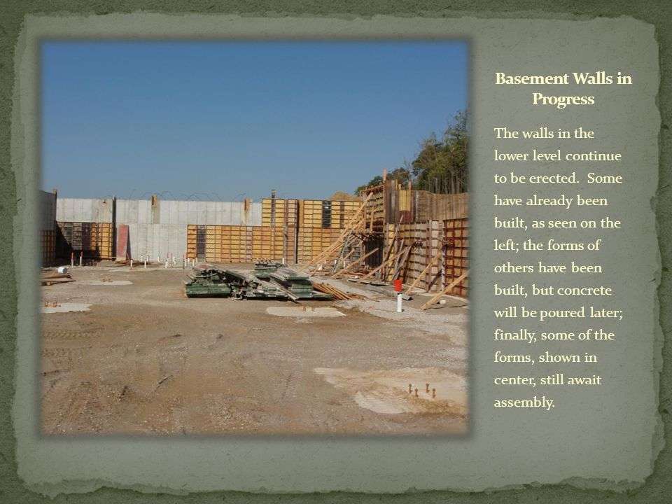 The walls in the lower level continue to be erected. Some have already been built, as seen on the left; the forms of others have been built, but concr