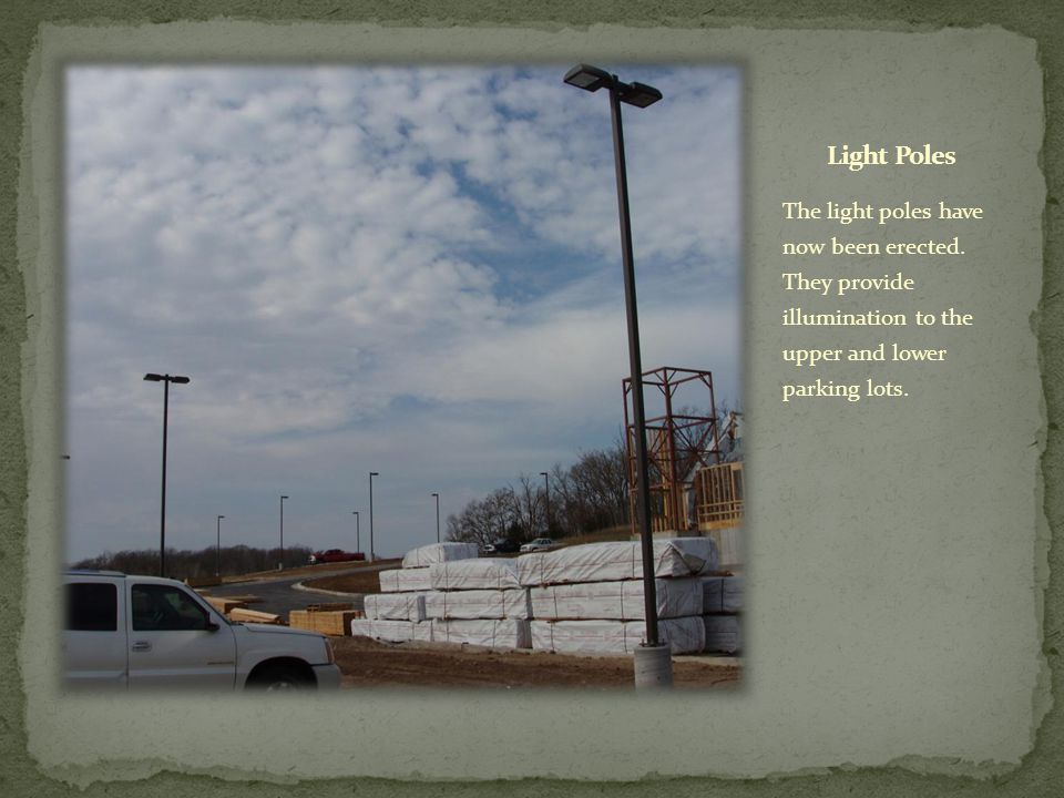 The light poles have now been erected. They provide illumination to the upper and lower parking lots.