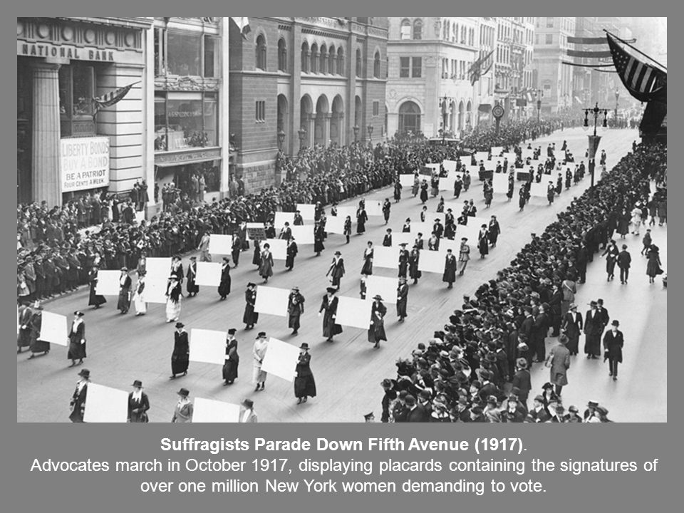 Suffragists Parade Down Fifth Avenue (1917). Advocates march in October 1917, displaying placards containing the signatures of over one million New Yo