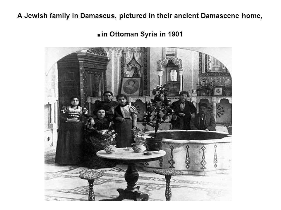 A Jewish family in Damascus, pictured in their ancient Damascene home, in Ottoman Syria in 1901.
