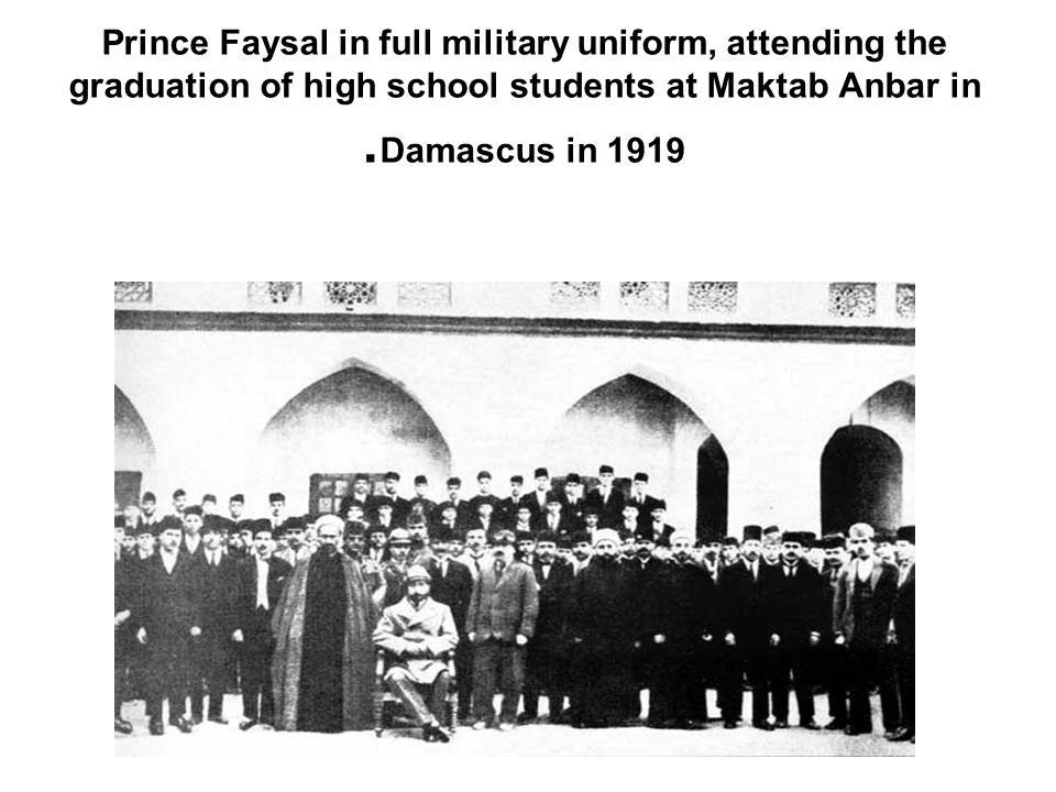 Prince Faysal in full military uniform, attending the graduation of high school students at Maktab Anbar in Damascus in 1919.