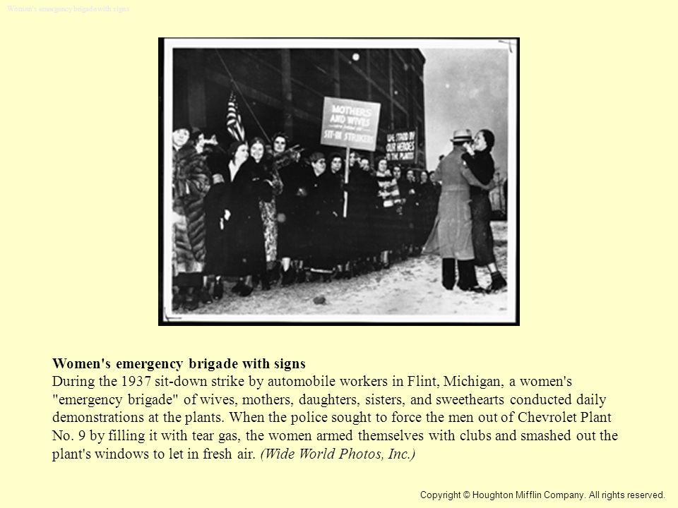 Women's emergency brigade with signs During the 1937 sit-down strike by automobile workers in Flint, Michigan, a women's