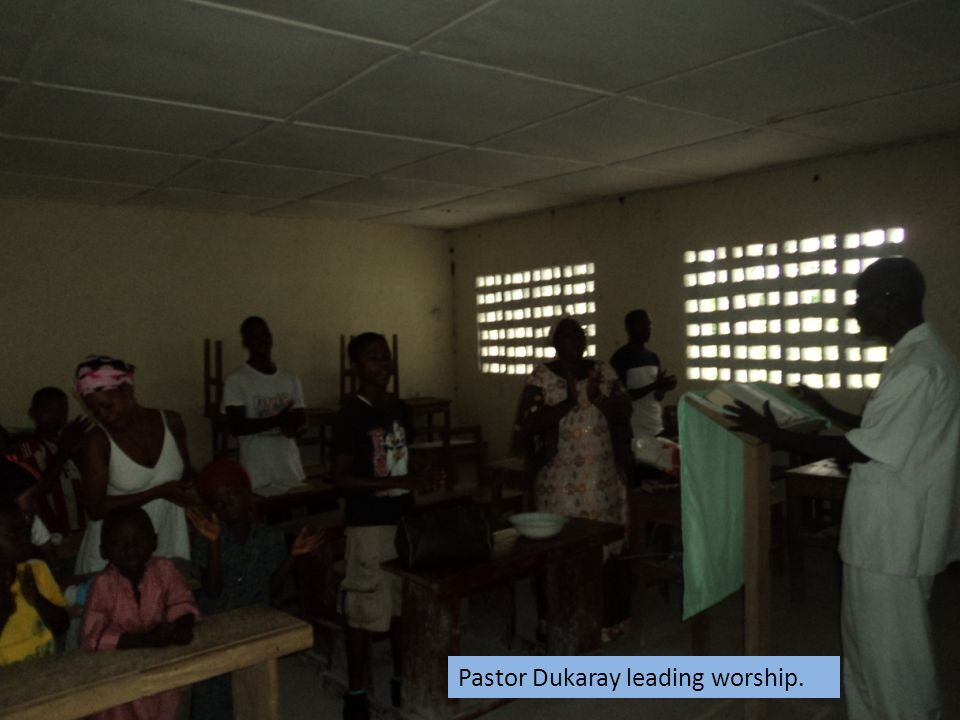 Pastor Dukaray leading worship.