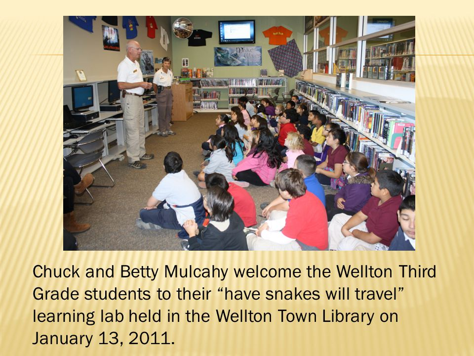 "Chuck and Betty Mulcahy welcome the Wellton Third Grade students to their ""have snakes will travel"" learning lab held in the Wellton Town Library on J"