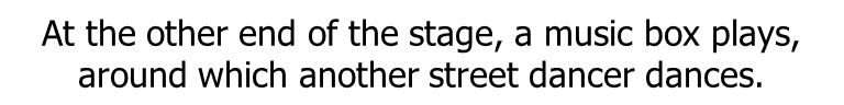 At the other end of the stage, a music box plays, around which another street dancer dances.