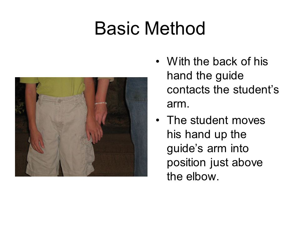 Basic Method With the back of his hand the guide contacts the student's arm.