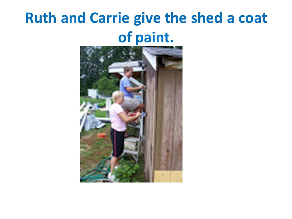 Ruth and Carrie give the shed a coat of paint.