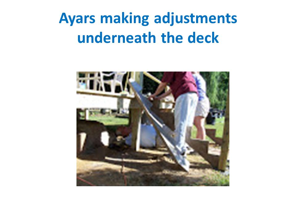 Ayars making adjustments underneath the deck