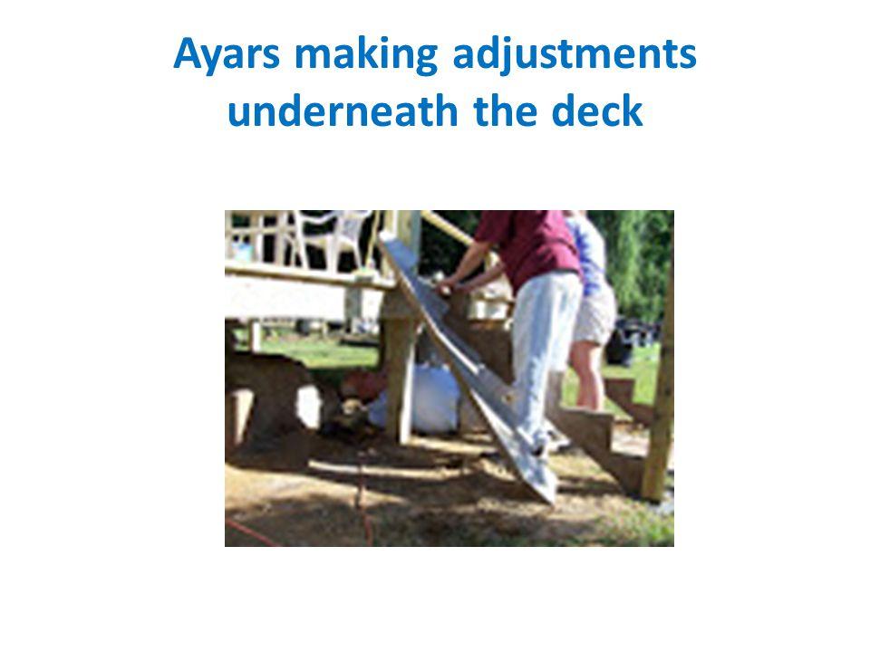 Ayars making adjustments underneath the deck