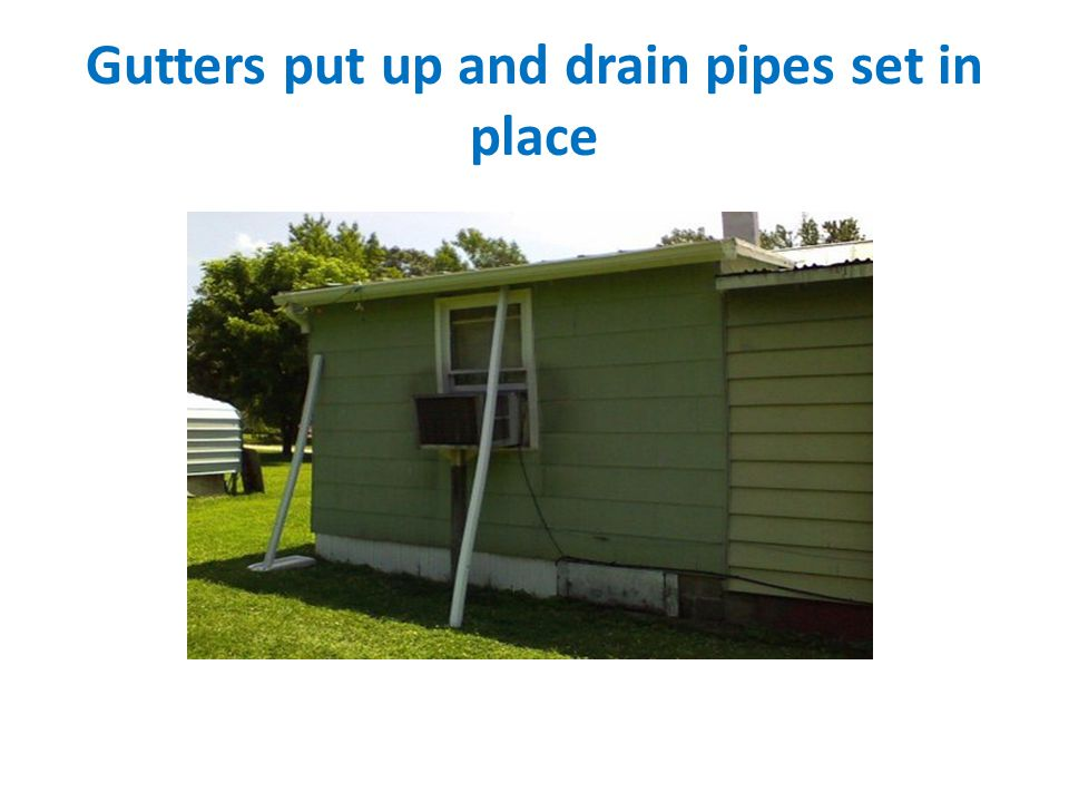 Gutters put up and drain pipes set in place