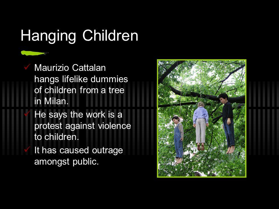 Hanging Children Maurizio Cattalan hangs lifelike dummies of children from a tree in Milan.