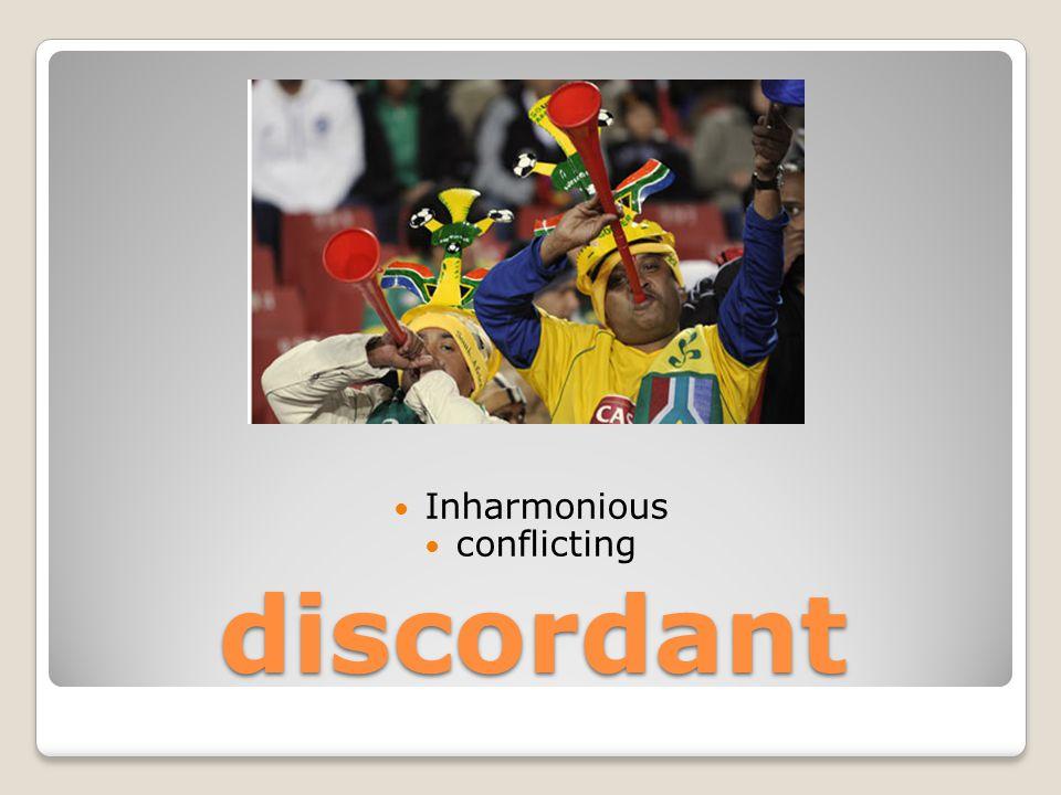 discordant Inharmonious conflicting