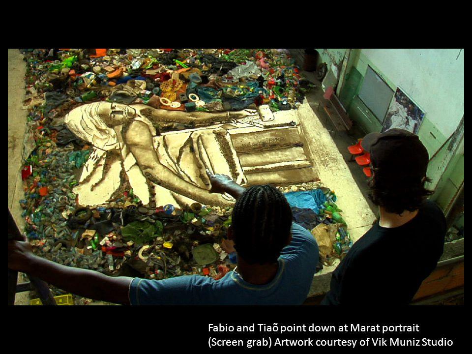 Fabio and Tiaõ point down at Marat portrait (Screen grab) Artwork courtesy of Vik Muniz Studio