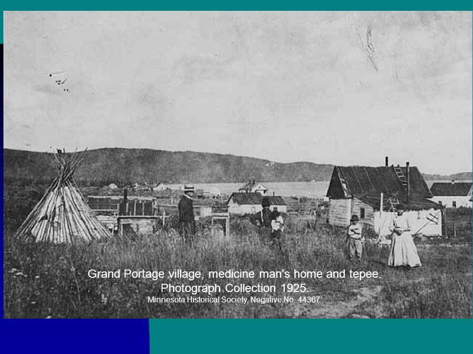 """Medicine"" on pole near grave of Mrs. John Nett Lake. Photograph Collection 9/1947. Minnesota Historical Society, Negative No. 35601"