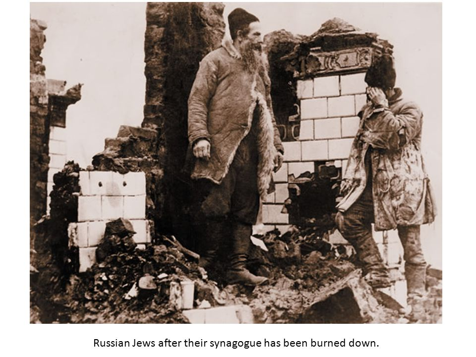 Russian Jews after their synagogue has been burned down.