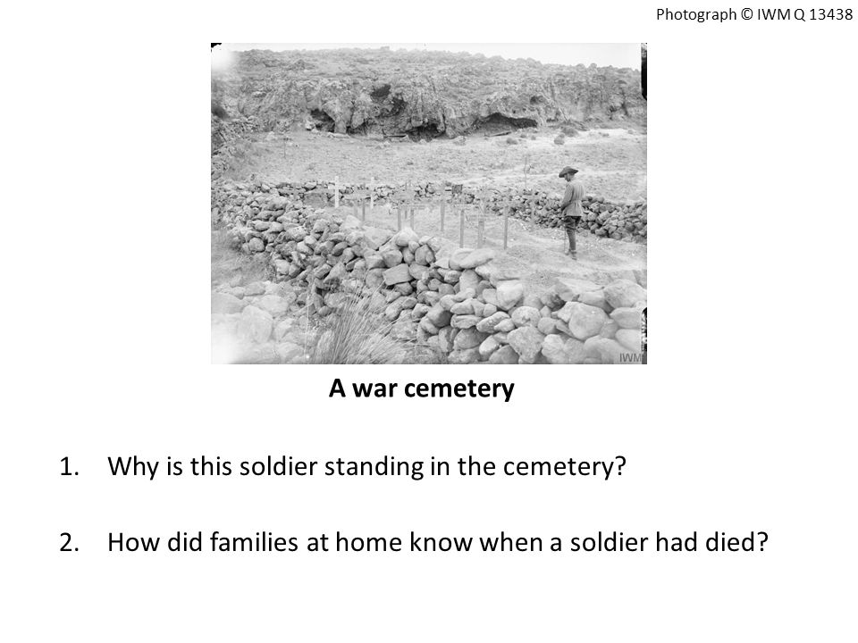 A war cemetery 1.Why is this soldier standing in the cemetery.