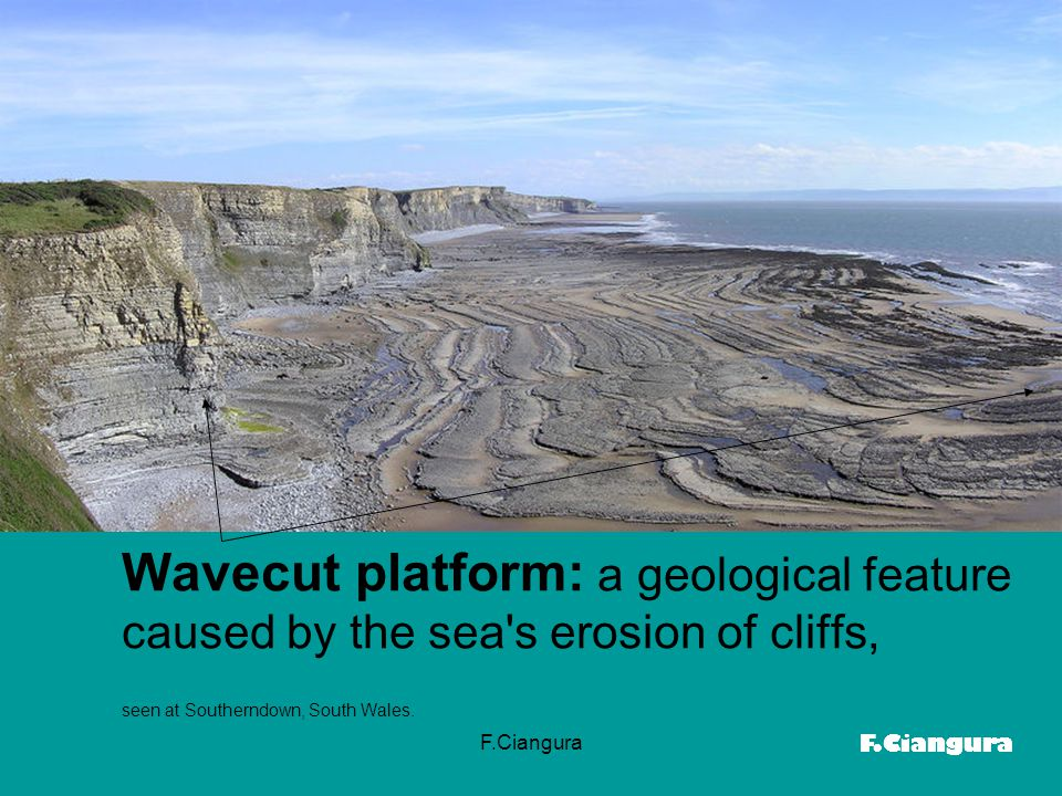 Wavecut platform: a geological feature caused by the sea s erosion of cliffs, seen at Southerndown, South Wales.