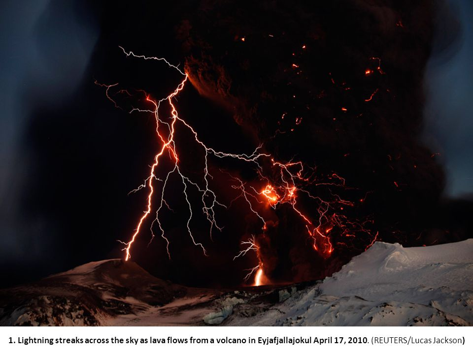 1. Lightning streaks across the sky as lava flows from a volcano in Eyjafjallajokul April 17, 2010.