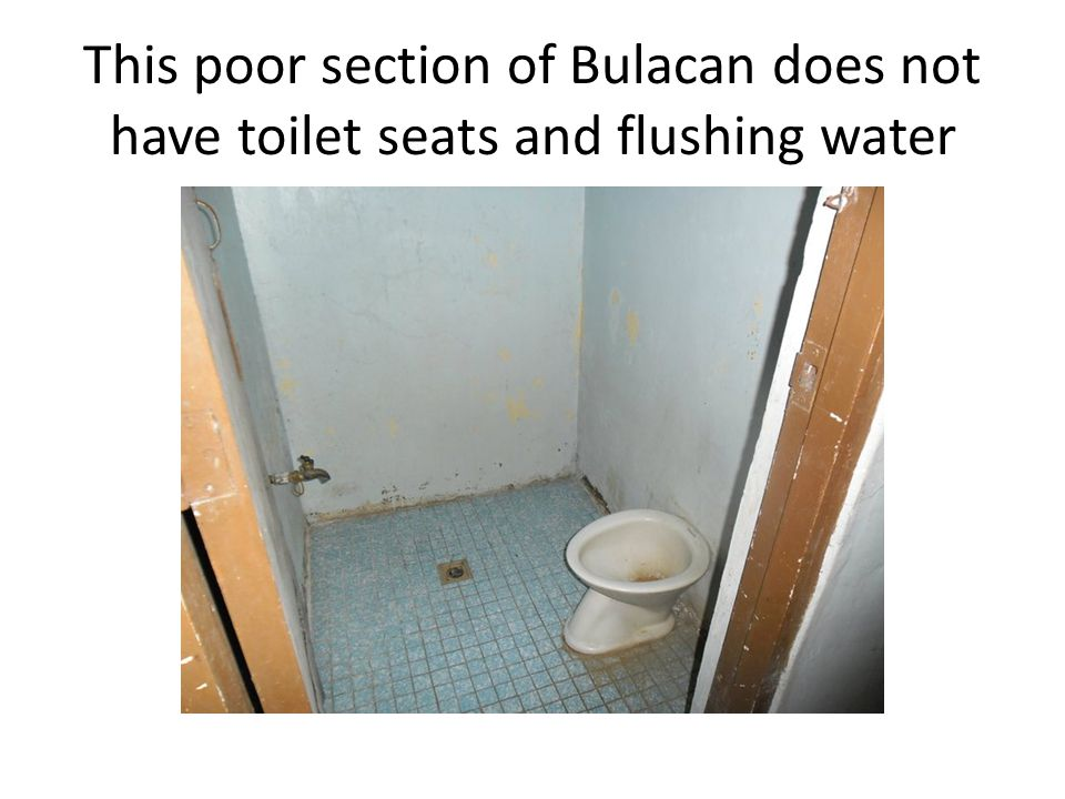 This poor section of Bulacan does not have toilet seats and flushing water