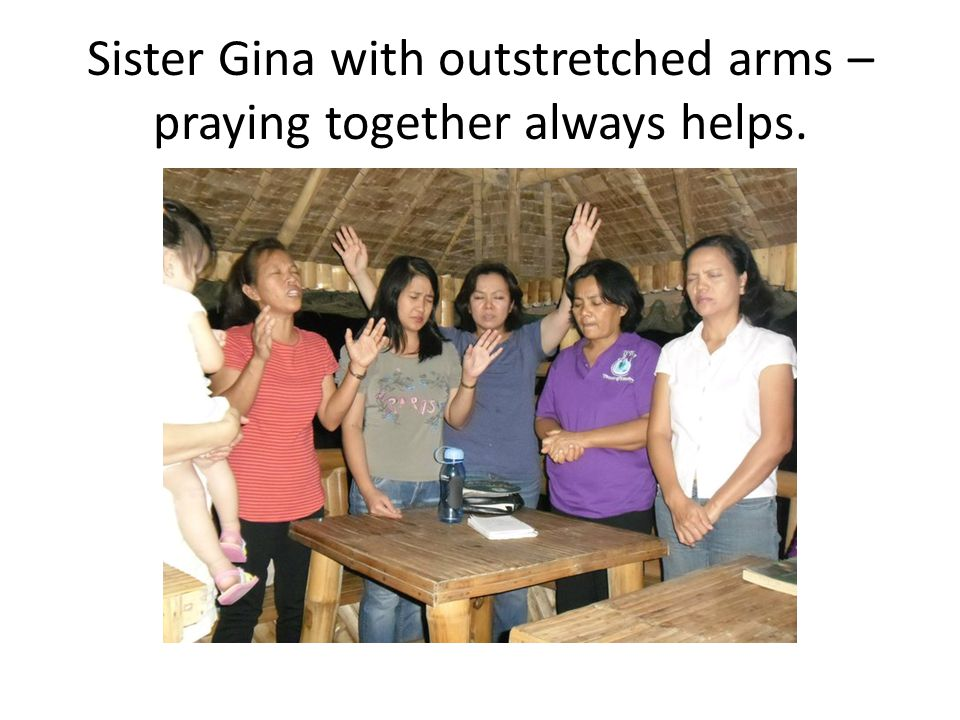Sister Gina with outstretched arms – praying together always helps.