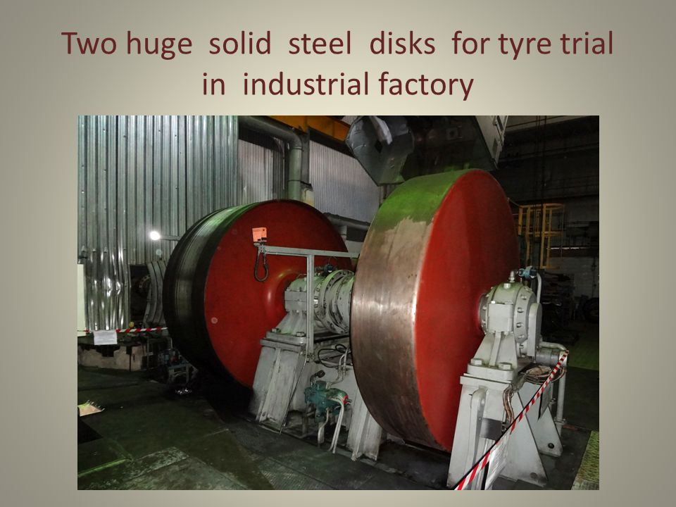Two huge solid steel disks for tyre trial in industrial factory