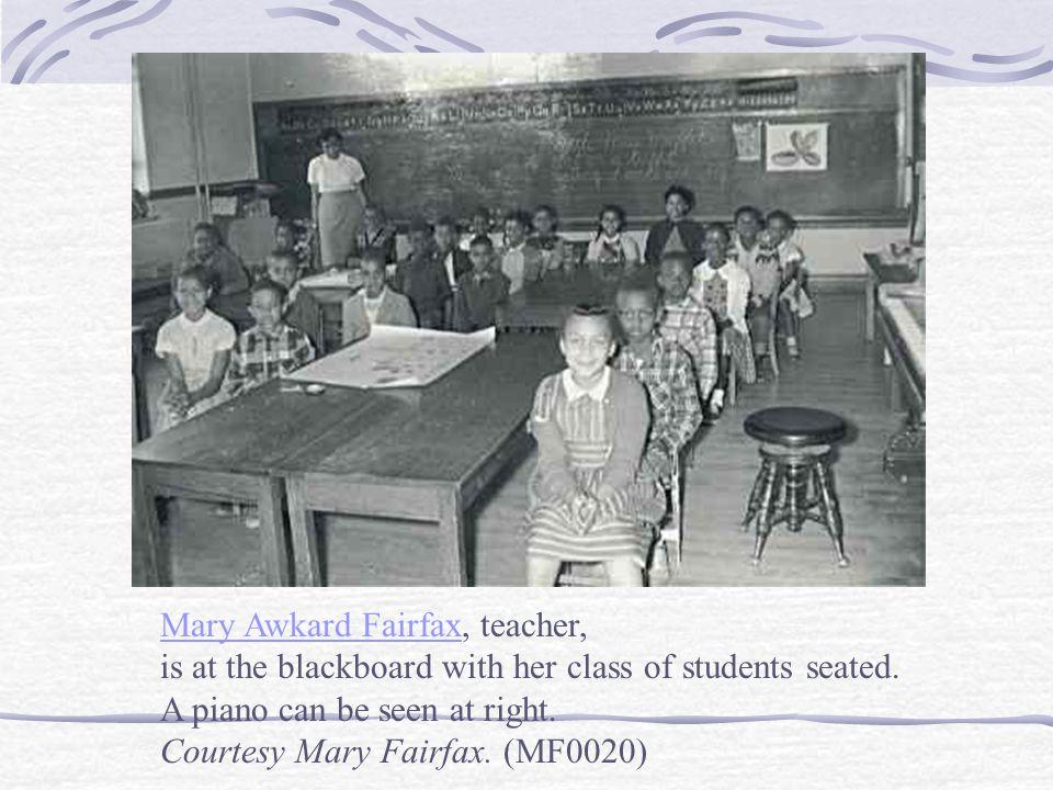 Mary Awkard FairfaxMary Awkard Fairfax, teacher, is at the blackboard with her class of students seated.