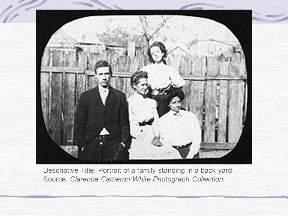 Descriptive Title: Portrait of a family standing in a back yard Source: Clarence Cameron White Photograph Collection.