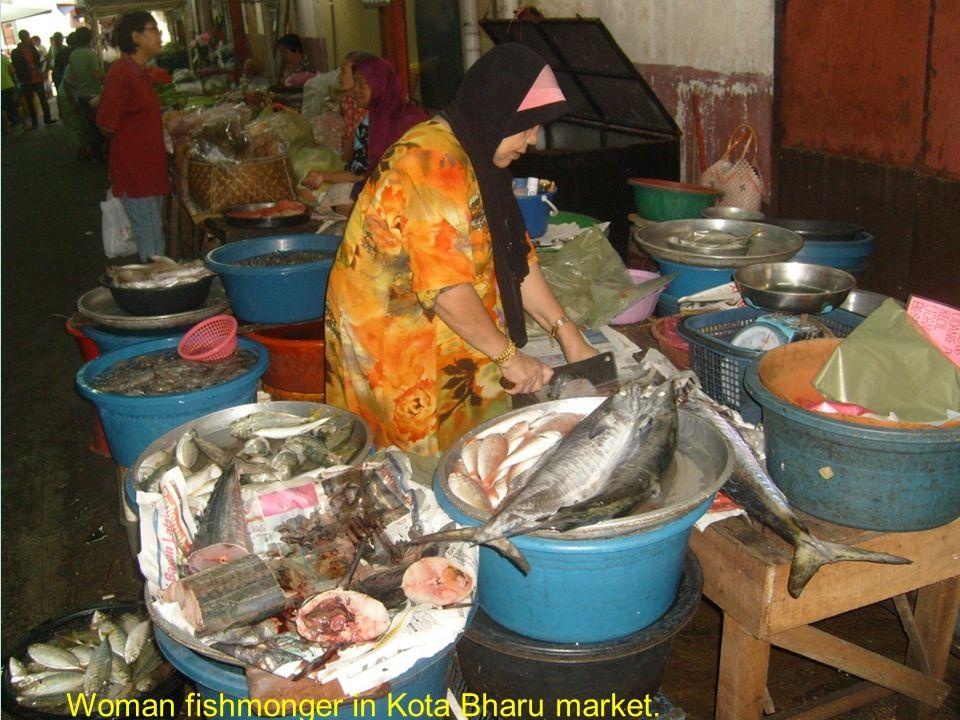Woman fishmonger in Kota Bharu market.