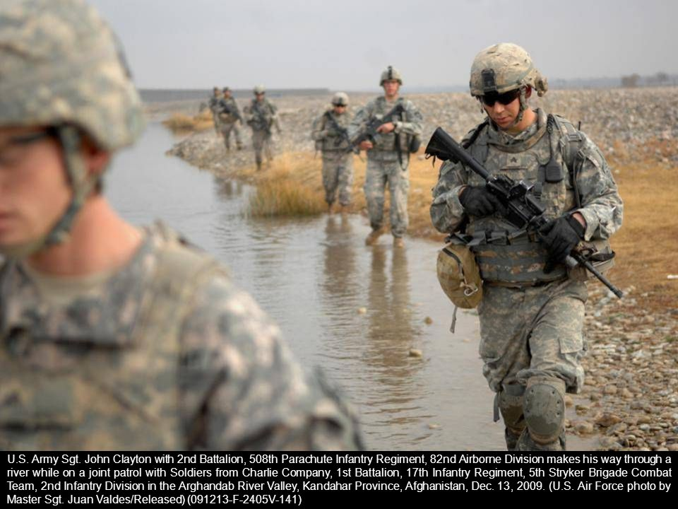 U.S. Army Sgt. John Clayton with 2nd Battalion, 508th Parachute Infantry Regiment, 82nd Airborne Division makes his way through a river while on a joi