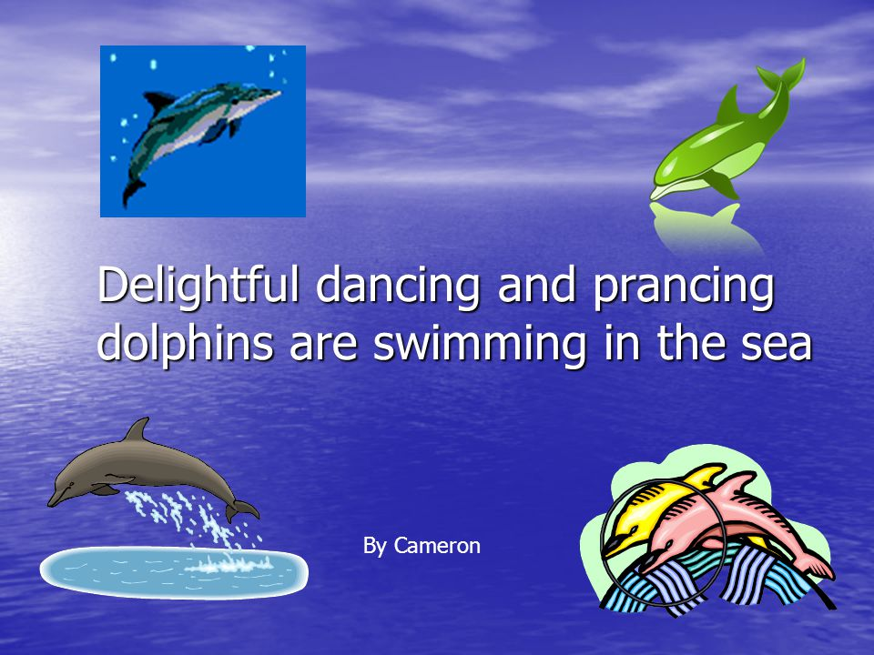 Delightful dancing and prancing dolphins are swimming in the sea By Cameron